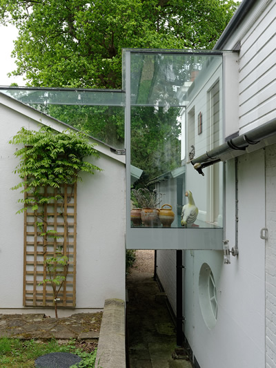 Glass linked attached extension.