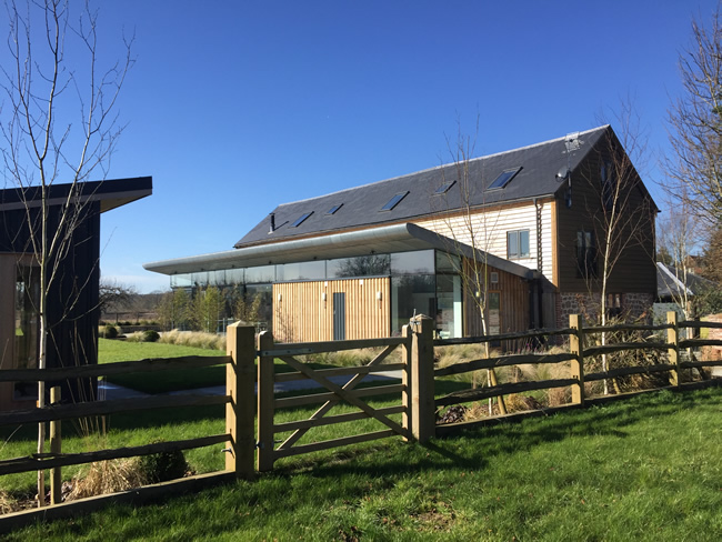 Contemporary extension to barn